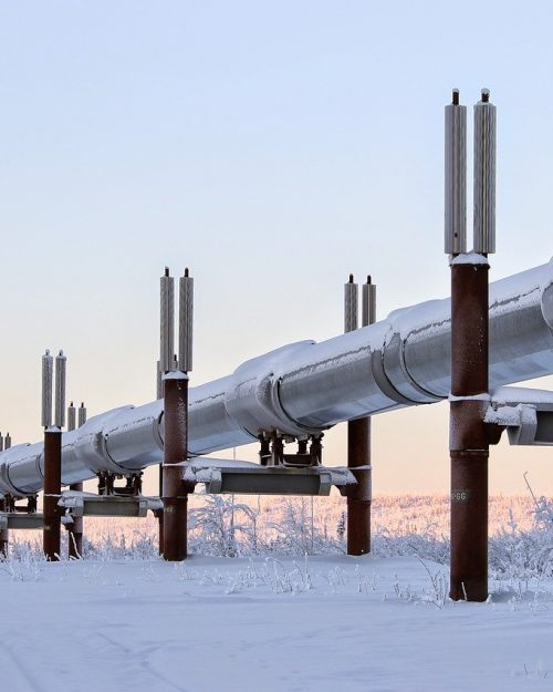 Big pipes in nature. Snow and sunset